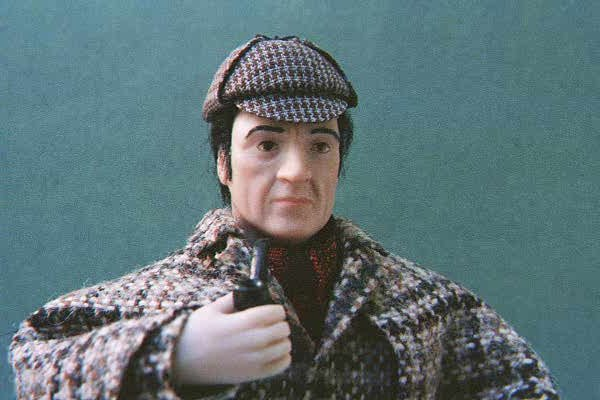 This is a Portrait Doll of Basil Rathbone