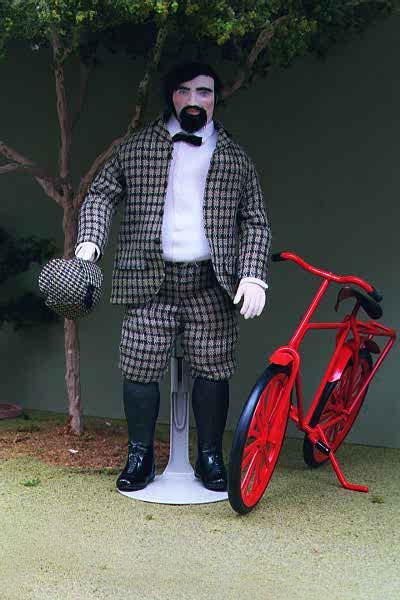 This Miniature Doll is called Vincent.  He stands next to his red bicycle.